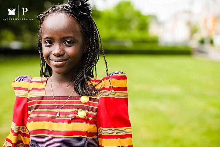 The Little Ugandan Mona Lisa in a Red Gomesi
