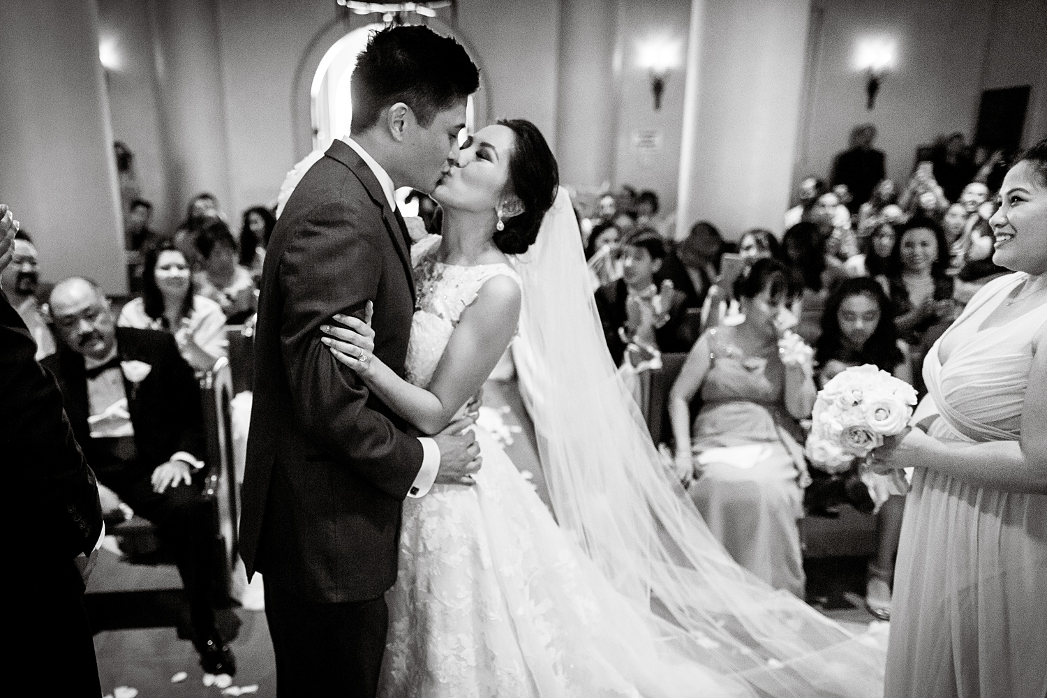 Newly Engaged Advice Filipino wedding kiss at Hilton Lake