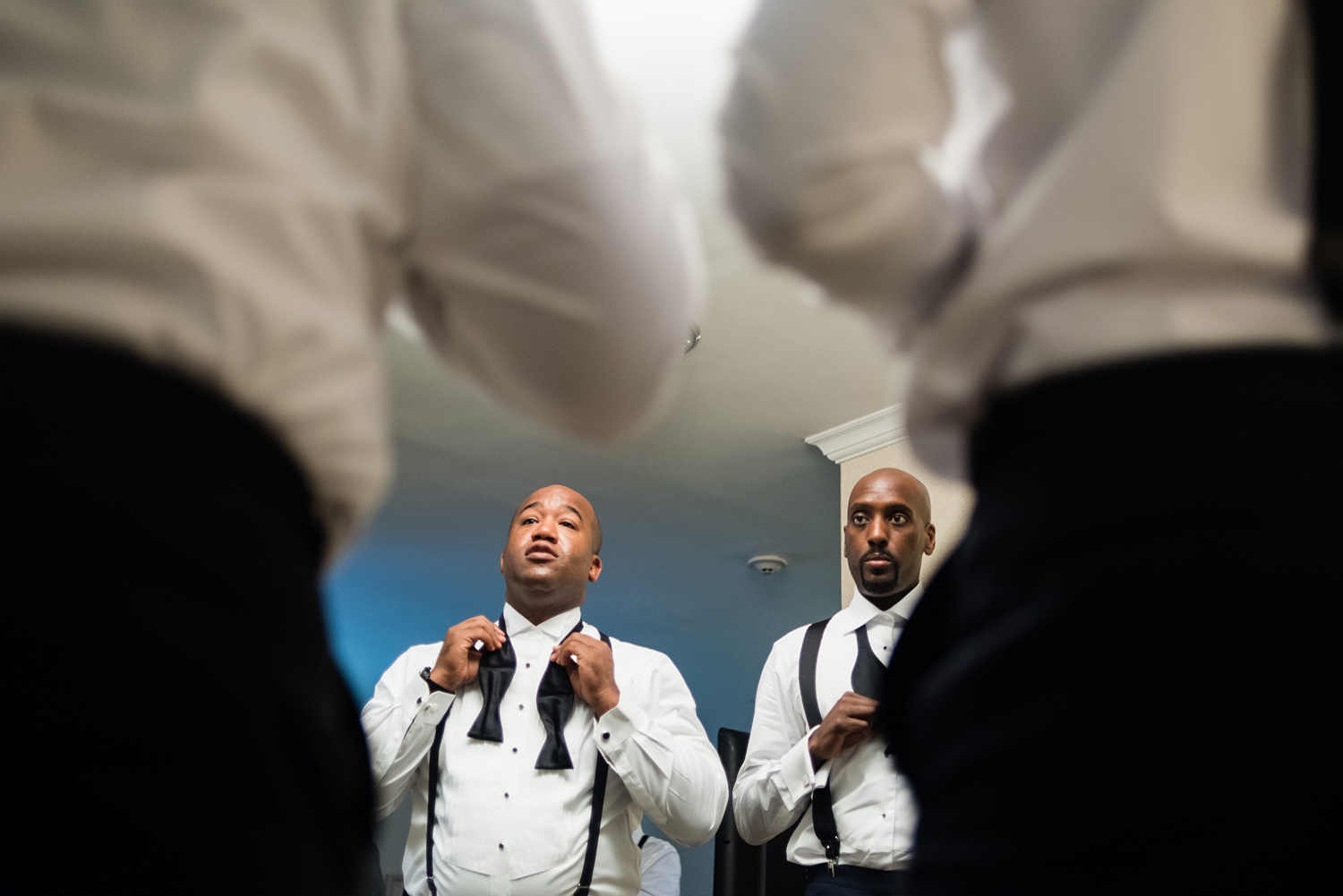 Newly Engaged Advice groomsmen getting ready at Paramount Country Club