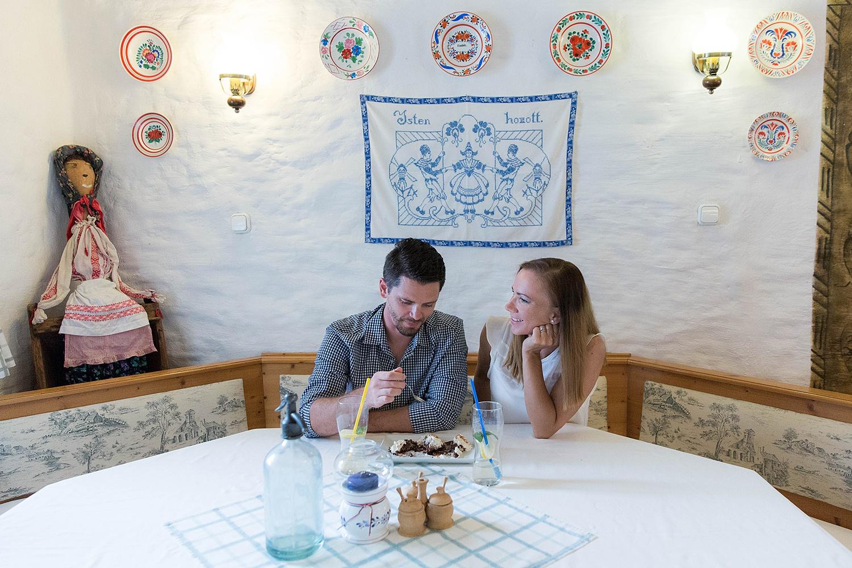 Multicultural spouses Adam and Edit Vasadi communicating at Hungarian restaurant