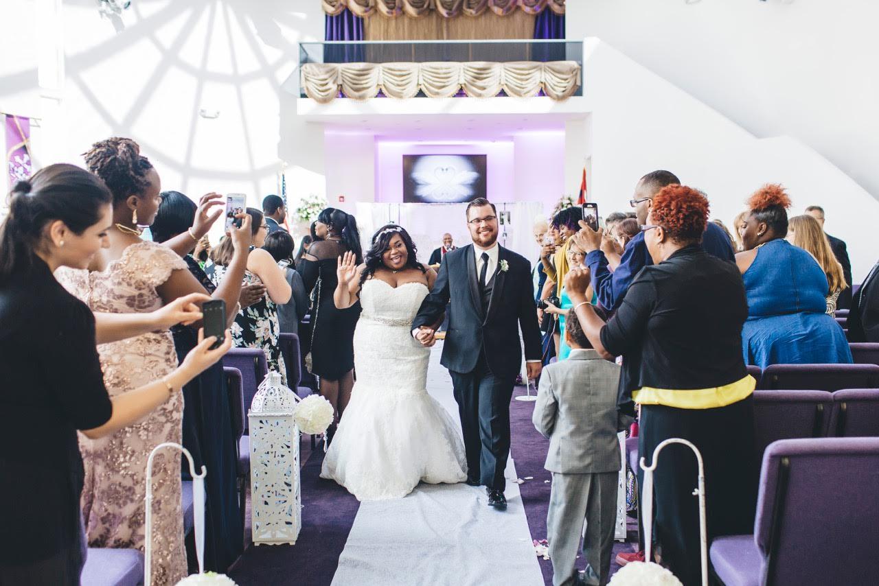 interracial newlyweds Khadijah Thomas on their wedding day in New York