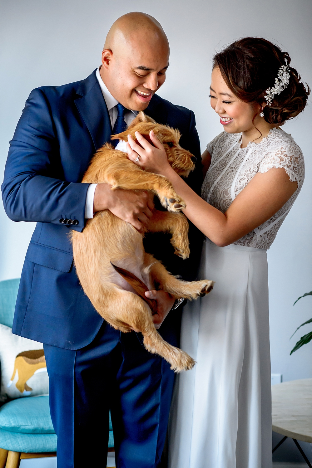 Chinese Filipino married couple on their wedding day petting dog Joshua Dwain I Am Multicultural Podcast