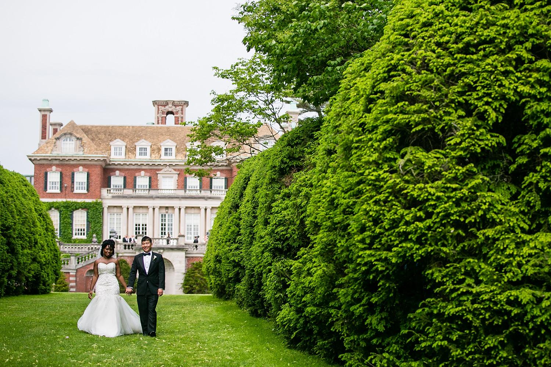 blasian bride and groom walking at Old Westbury Gardens