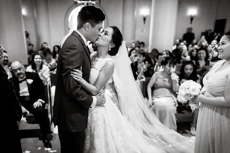 Newly Engaged Advice Filipino wedding kiss at Hilton Lake